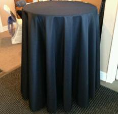 crusier tables available for rent with black tablecloth also available for rent